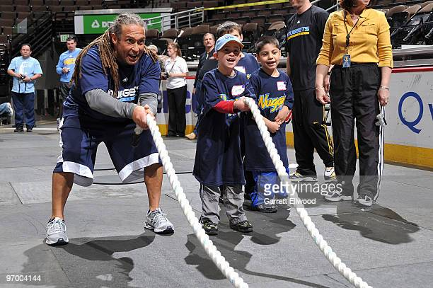 Strength and conditioning coach Steve Hess of the Denver Nuggets works with a participant from the Special Olympics of Colorado on February 23 2010...