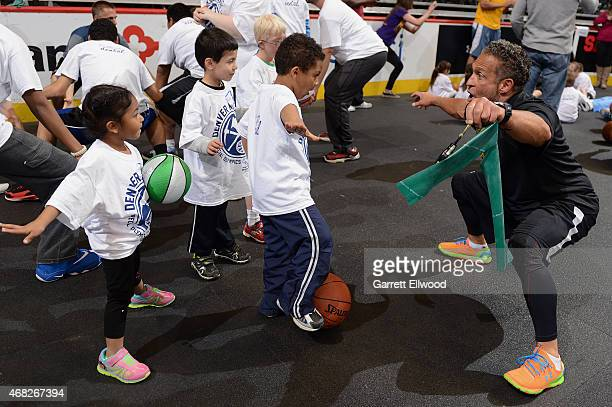 Strength and Conditioning coach Steve Hess of the Denver Nuggets takes part in a basketball clinic for Special Olympics athletes from Colorado on...
