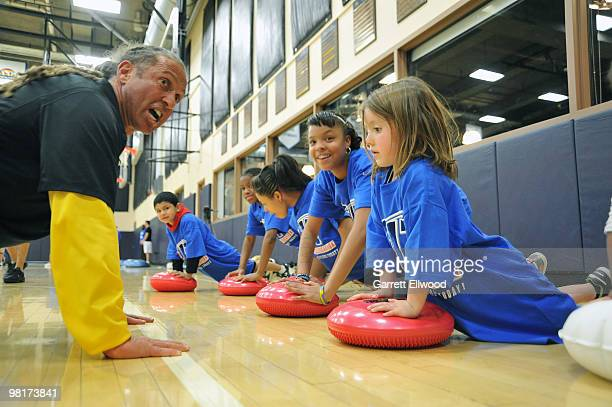 Strength and conditioning coach Steve Hess of the Denver Nuggets instructs children from the Boettcher Boys and Girls Club during a Denver Nuggets...