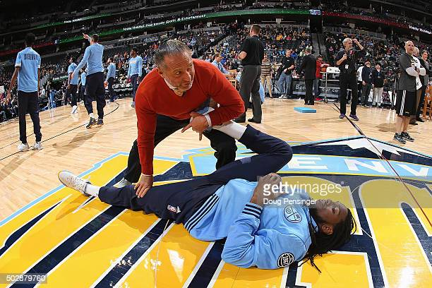 Strength and conditioning coach Steve Hess works with Kenneth Faried of the Denver Nuggets during warm up prior to facing the Cleveland Cavaliers at...