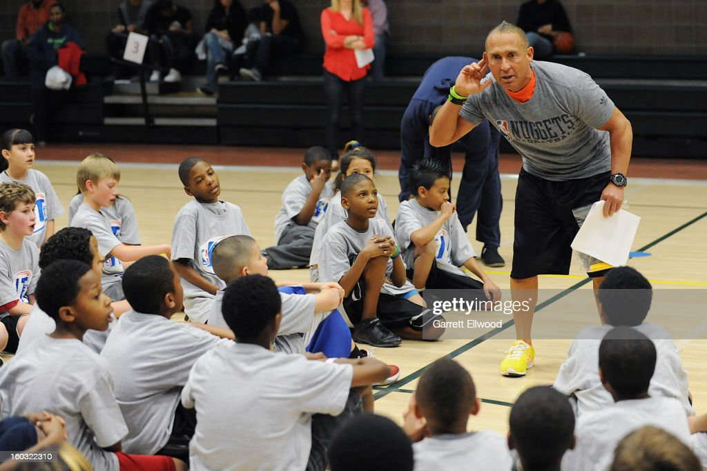 Strength and Conditioning/Assistant Coach Steve Hess of the Denver Nuggets talks to children during a Team Fit Clinic on January 25, 2013 at the Hiawatha Davis Recreation Center in Denver, Colorado.