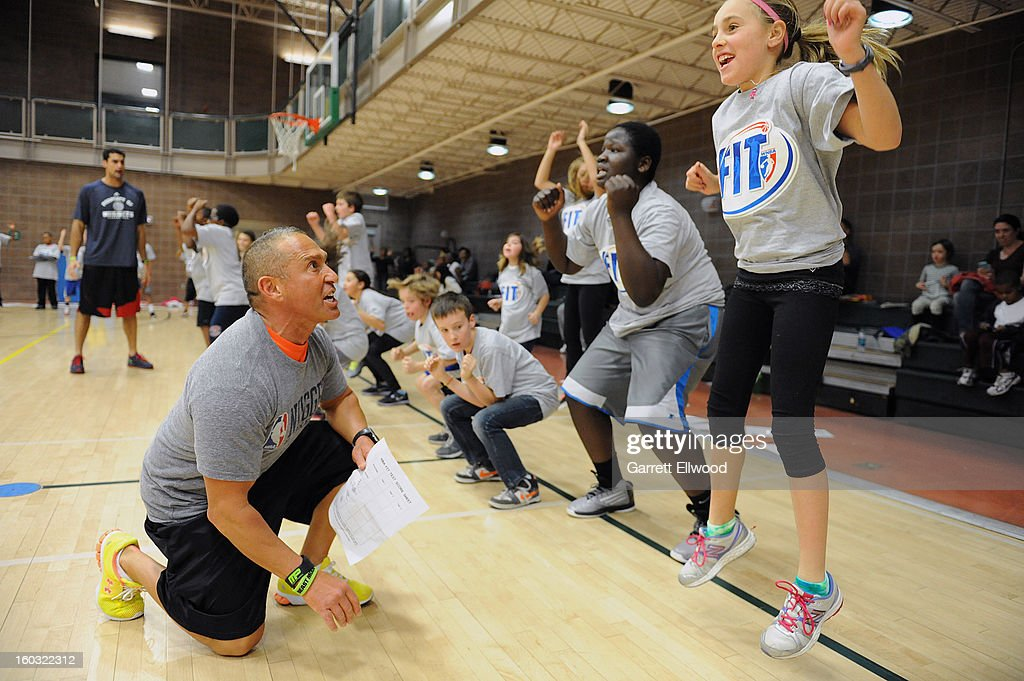 Strength and Conditioning/Assistant Coach Steve Hess of the Denver Nuggets instructs children during a Team Fit Clinic on January 25, 2013 at the Hiawatha Davis Recreation Center in Denver, Colorado.
