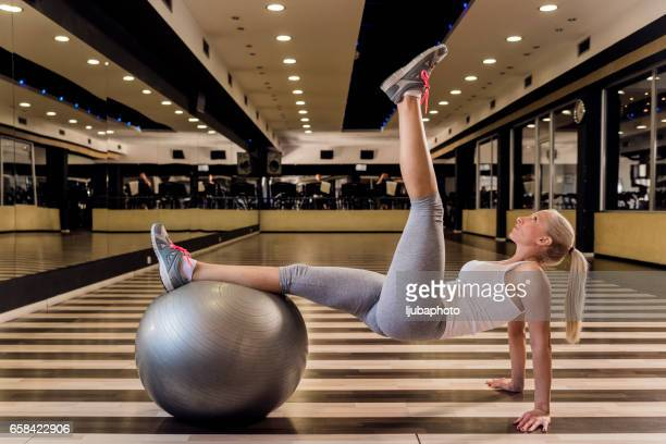 Strengthening her core muscles