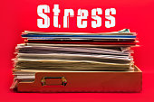 A Full To Do Tray and the Word Stress on Red Background