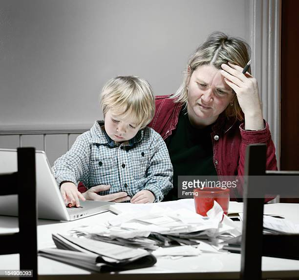 Stressed and tired mother working on financial issues