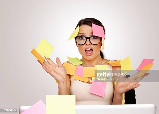 Stressed business woman with sticky notes stuck to her body