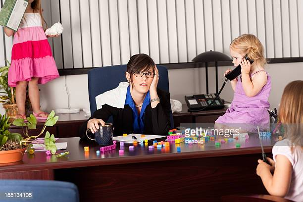 Stressed Business Woman Working with Children in Office