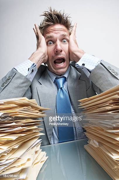 Stressed Businessman Office Worker Is Overwhelmed with Paperwork