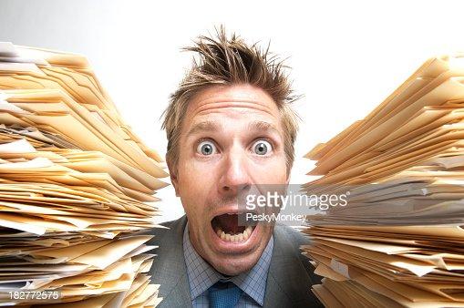Stressed Businessman Office Worker Screaming for Help Between File Folders