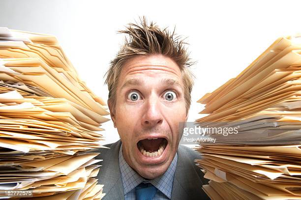 Stressed Businessman Office Worker Screaming for Help Between File Folders