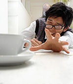 Stressed Businessman Reaching For Coffee Cup