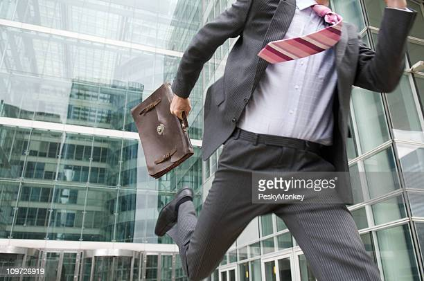 Stressed Businessman Rushing Outdoors From the Office Courtyard