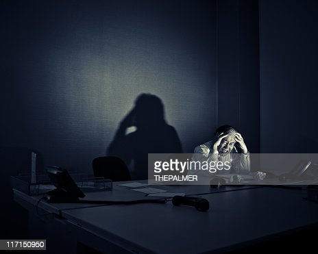 stressed businessman sitting alone in his office