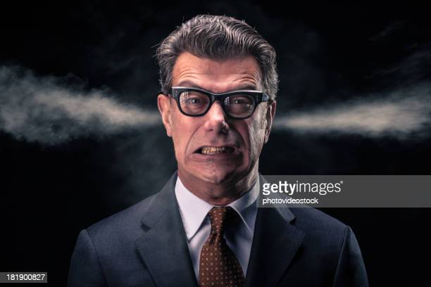 Stressed Businessman with Steam Jets Blowing out of his Ears