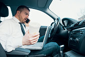 Stressed businessman working seated in his car