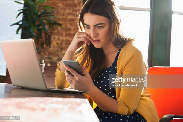 Stressed Caucasian businesswoman using cell phone