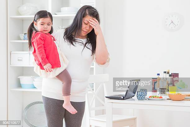 Stressed Chinese Mother and Baby
