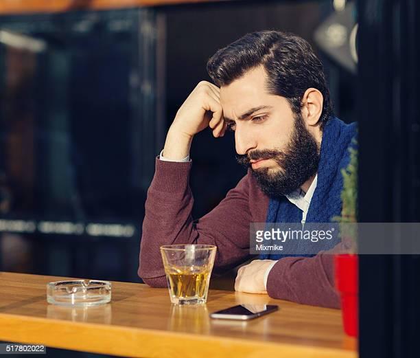Stressed man in a bar