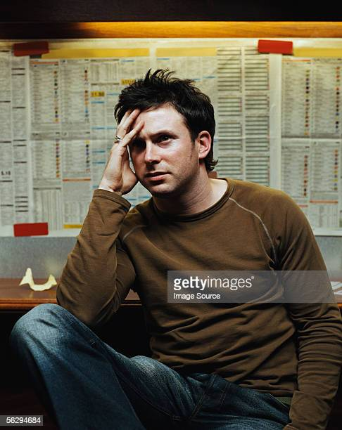 Stressed man in a betting shop