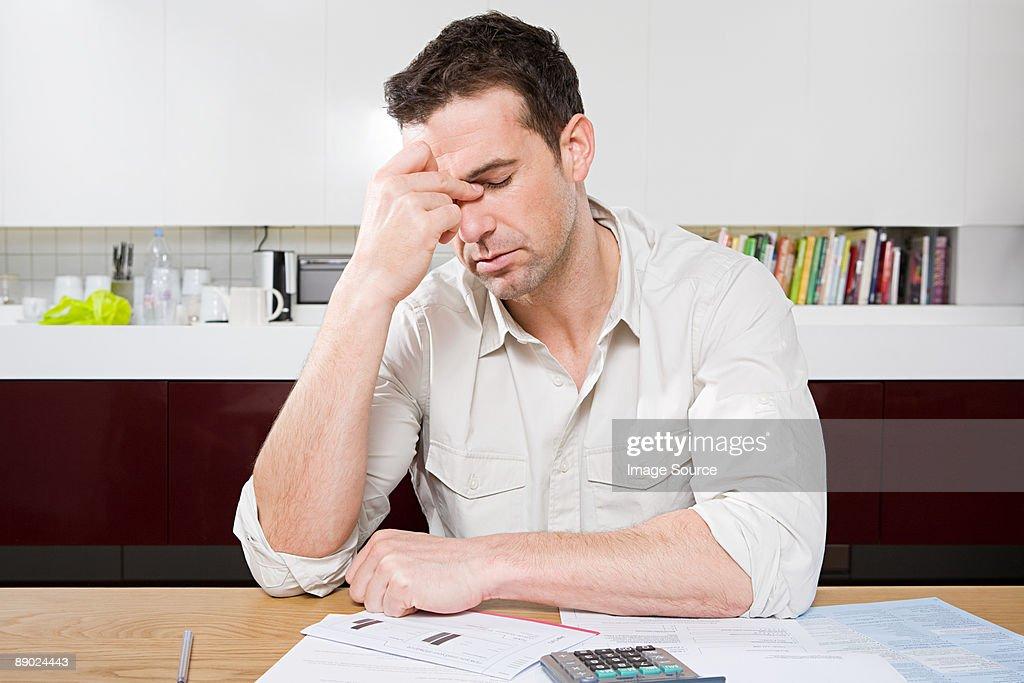 Stressed man with bills