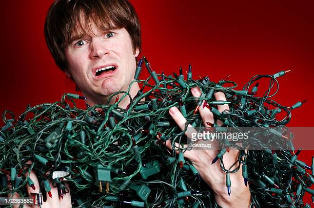 Stressed Man with Bunch of Tangled Christmas Lights