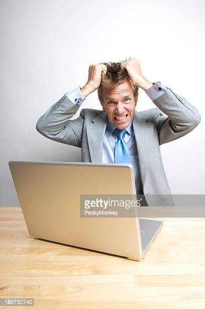 Stressed Office Worker Businessman Tearing His Hair Out at Desk