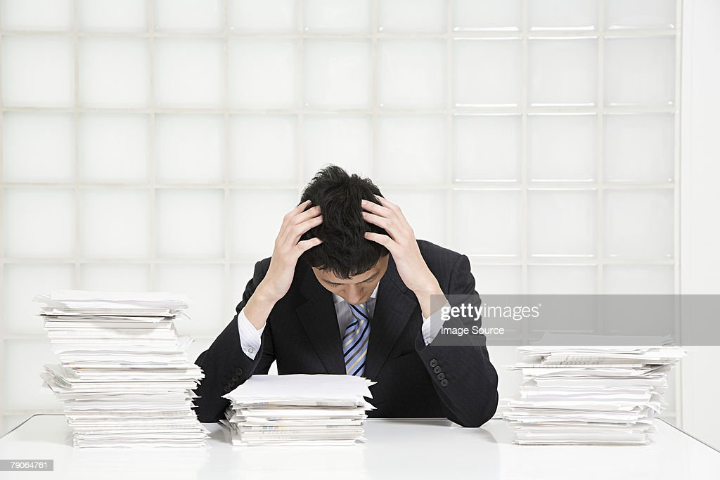 A stressed office worker : Stock Photo