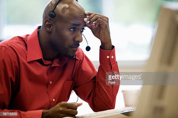 Stressed Out Man with Headset
