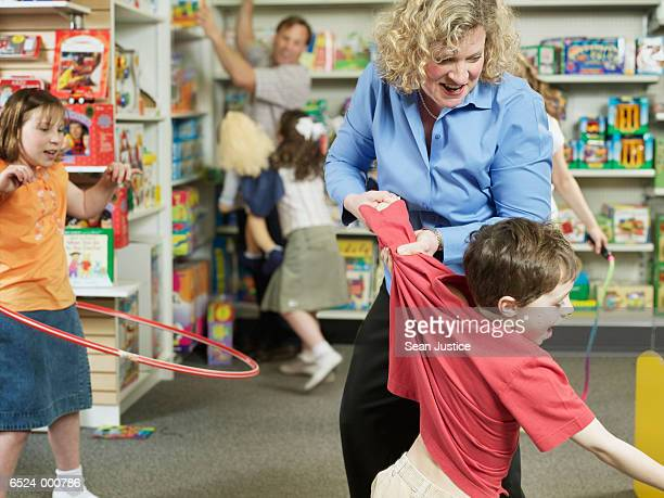 Stressed Parents in Toy Store