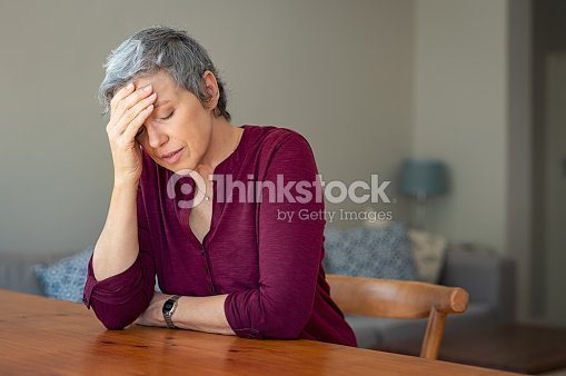 Stressed senior woman at home : Stock Photo