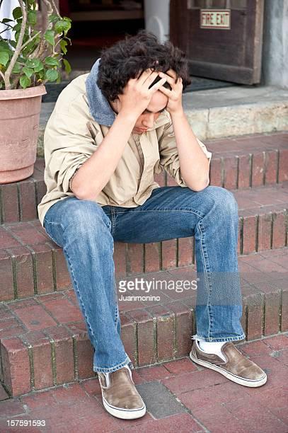 Stressed teenage boy