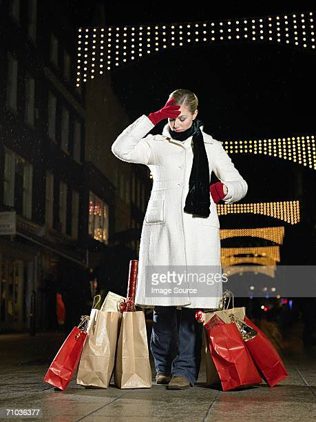 Stressed woman christmas shopping
