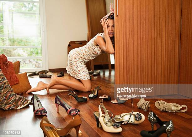 Stressed woman looking for shoes