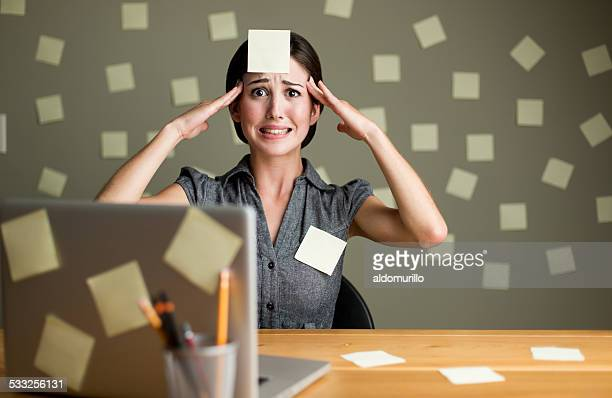 Stressed woman with post its