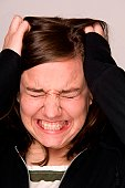 Stressed-out woman, holding head.