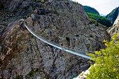 Stressed-ribbon bridge across Massa Gorge, Belalp tourism region, Canton of Valais, Switzerland