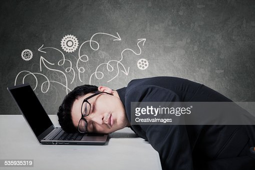 Stressful manager sleeping on laptop : Stock Photo