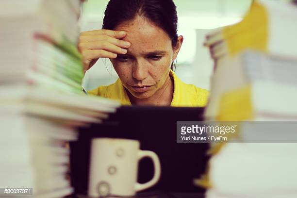 Stressful Woman Working In Office
