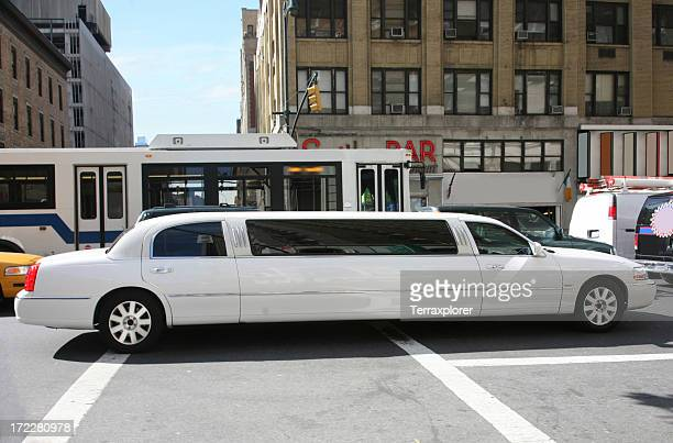 Stretch Limousine In City Traffic