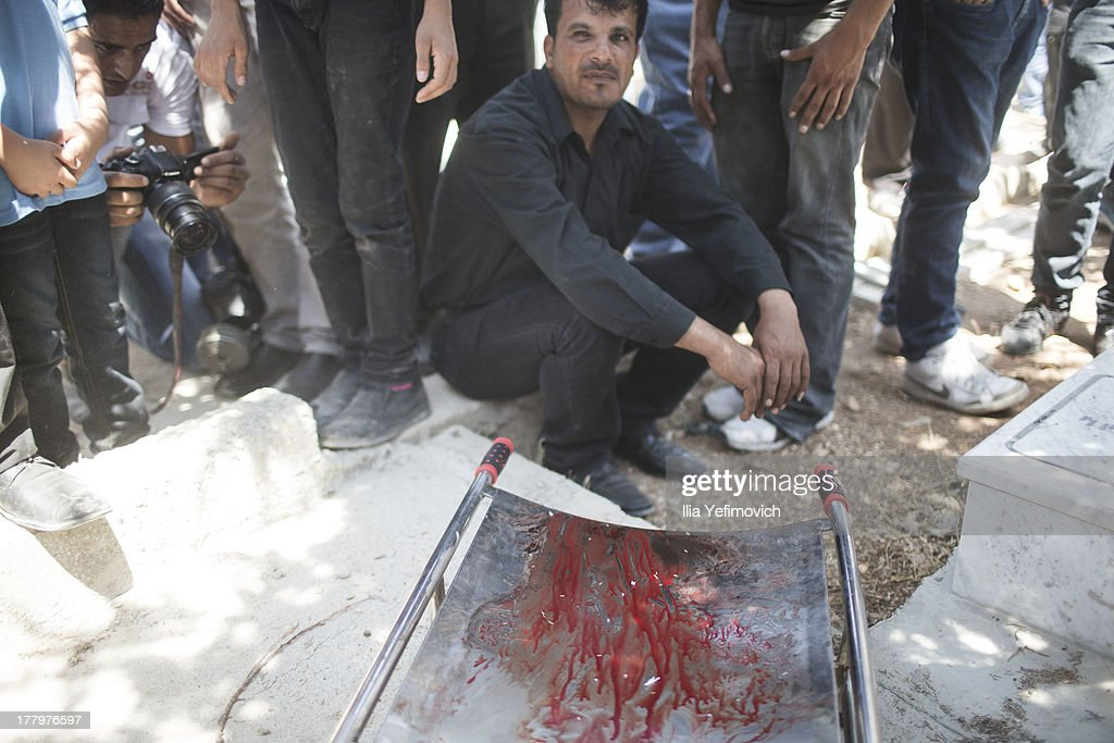 A stretcher is seen during the funeral held for three Palestinians killed during IDF operation at Kalandia refugee camp on August 26, 2013 in Ramallah, West Bank. At least 15 people were injured as Palestinians clash with undercover Israeli troops.