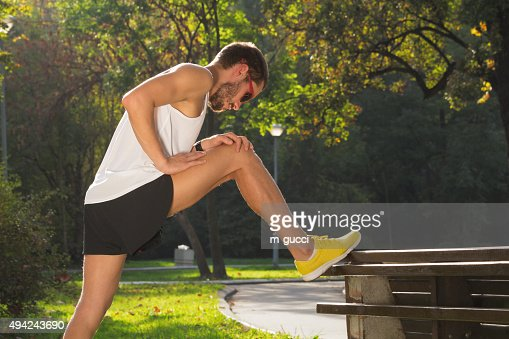 Stretching after jogging/excercise : Stock Photo