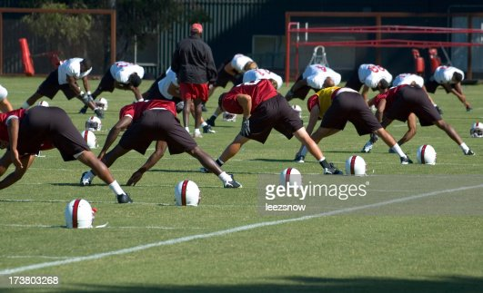 Stretching at Football Practice