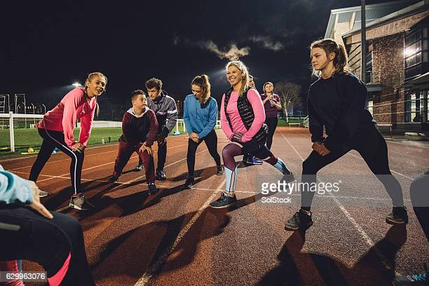 Stretching Before a Training Session at the Track