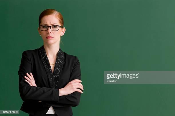 strict teacher at blackboard