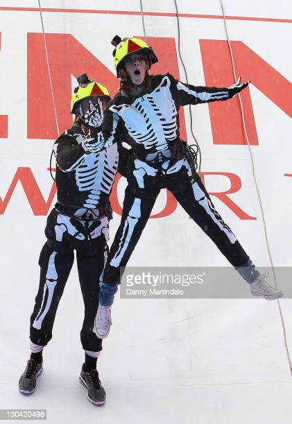 Strictly Come Dancing's Alex Jones and dance partner James Jordan absail down the Vienna Tourist Board's 21m high vertical stage in Trafalgar Square...