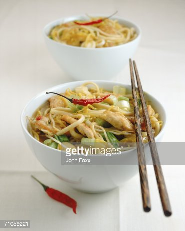 Stri-fried, noodles and chilli pepper with chopsticks in bowl, close-up : Foto stock
