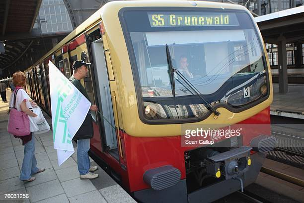A strike coordinator of the German locomotive drivers' union talks to a nonunionized and not striking SBahn commuter train driver during a GDL strike...