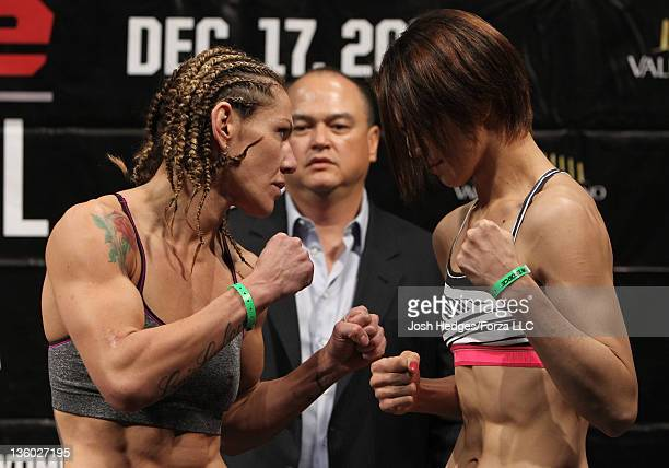 Strikeforce Womens Featherweight Champion Cristiane 'Cyborg' Santos and challenger Hiroko Yamanaka face off aftering weighing in during the...