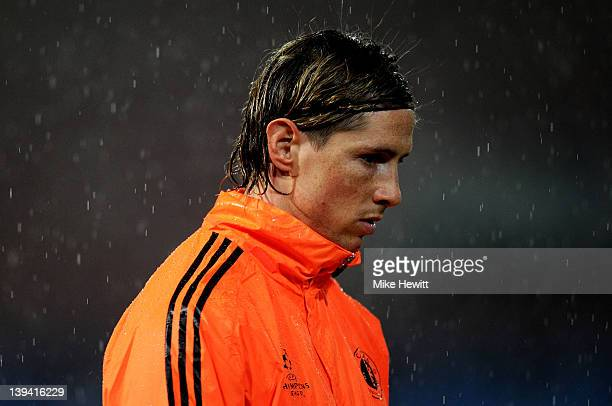 Striker Fernando Torres looks on in wet conditions during the Chelsea training session ahead of the UEFA Champions League round of sixteen first leg...