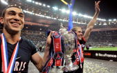 Striker Mevlut Erding of Paris Saint Germain football club and midfielder Christophe Jallet hold the trophy after winning the French Cup Football...